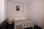 Кровать в номере Apartments VIP