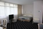Кровать в номере Studio