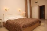 Кровать в номере Suite Duplex